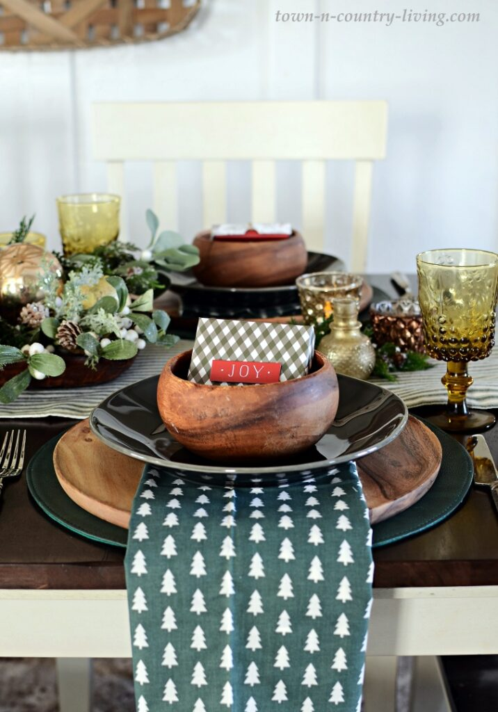 Wood Bowls and Chargers Pair with Dark Gray Plates and Dark Green Placemats for Christmas