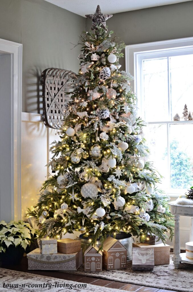 Natural Green Christmas Tree with White Ornaments and Ribbons