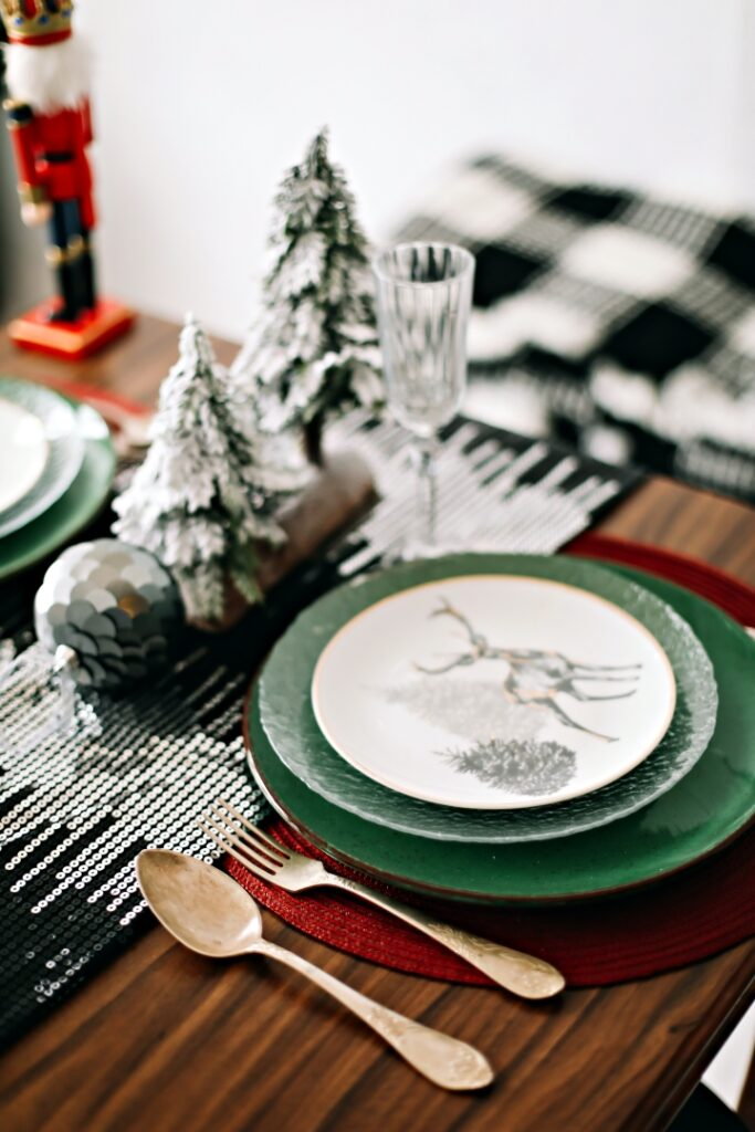 Festive table setting for Christmas dinner at home. New year and Christmas decorations. Winter holiday theme. Happy New Year.