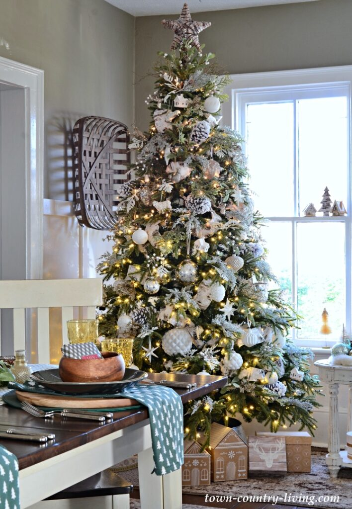 Green Christmas Tree with White Ornaments in Country Style Dining Room