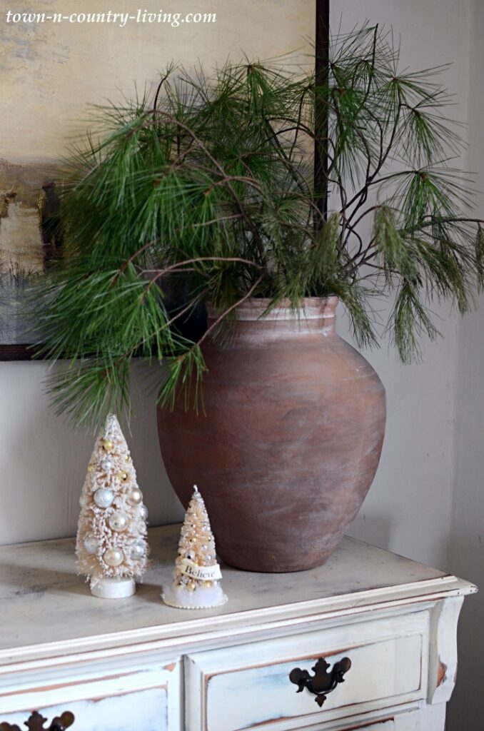 Christmas Evergreen Branches in Earthy Artisan Vase