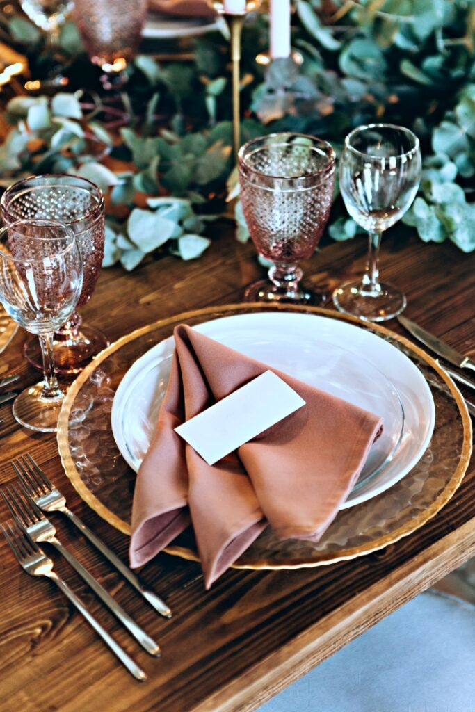 Holiday table setting with creatively folded napkin