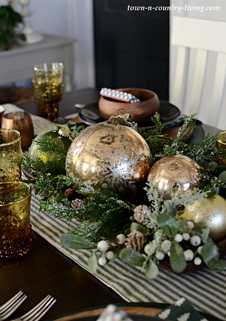 Reproduction Dough Bowl Filled with Metallic Ornaments and Greens