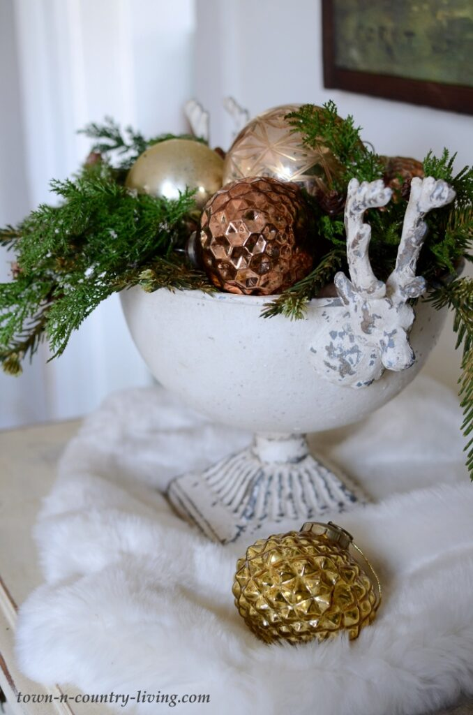 Reindeer Pedestal Bowl with Metallic Ornaments and Greenery