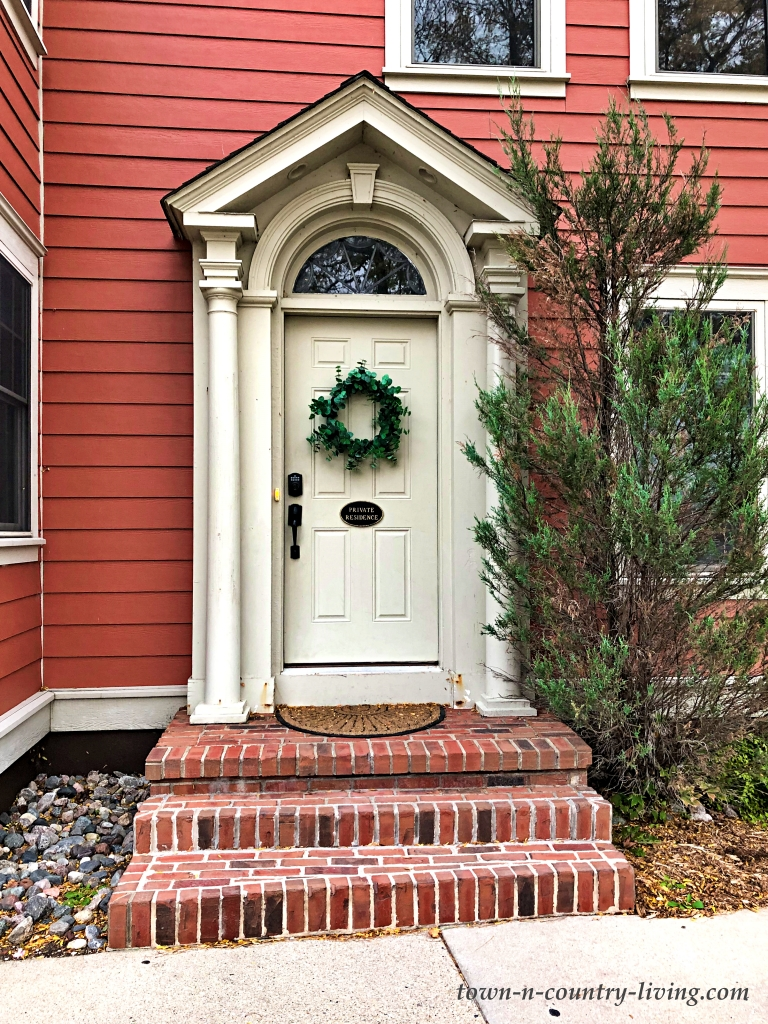 Cream Colored Front Door of Red House