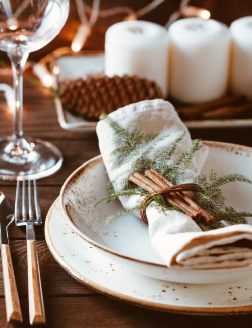 Thanksgiving table setting with linen napkins and cinnamon sticks