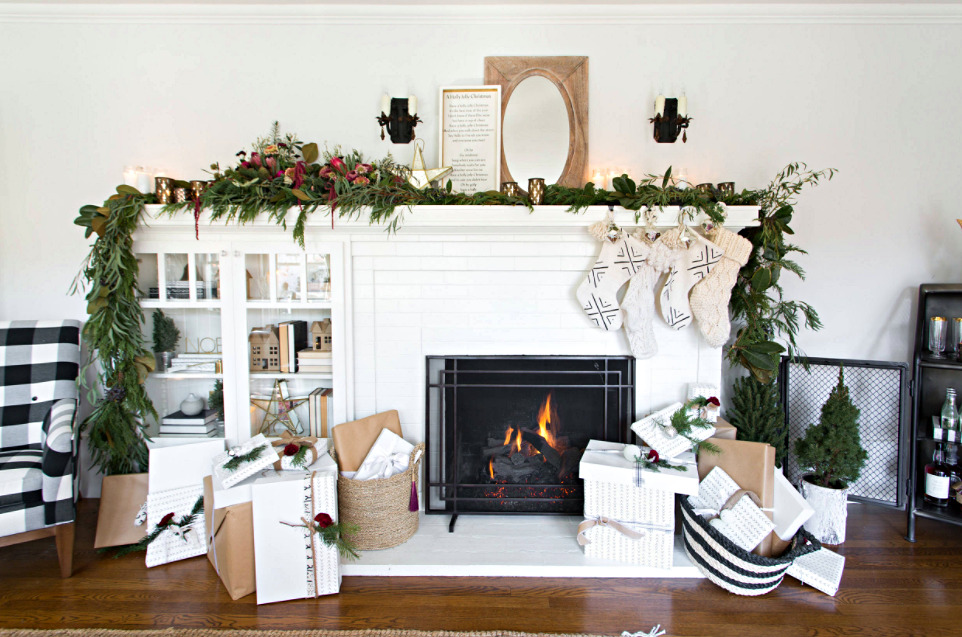 Christmas Bungalow Tour - White Fireplace with Garland and Stockings