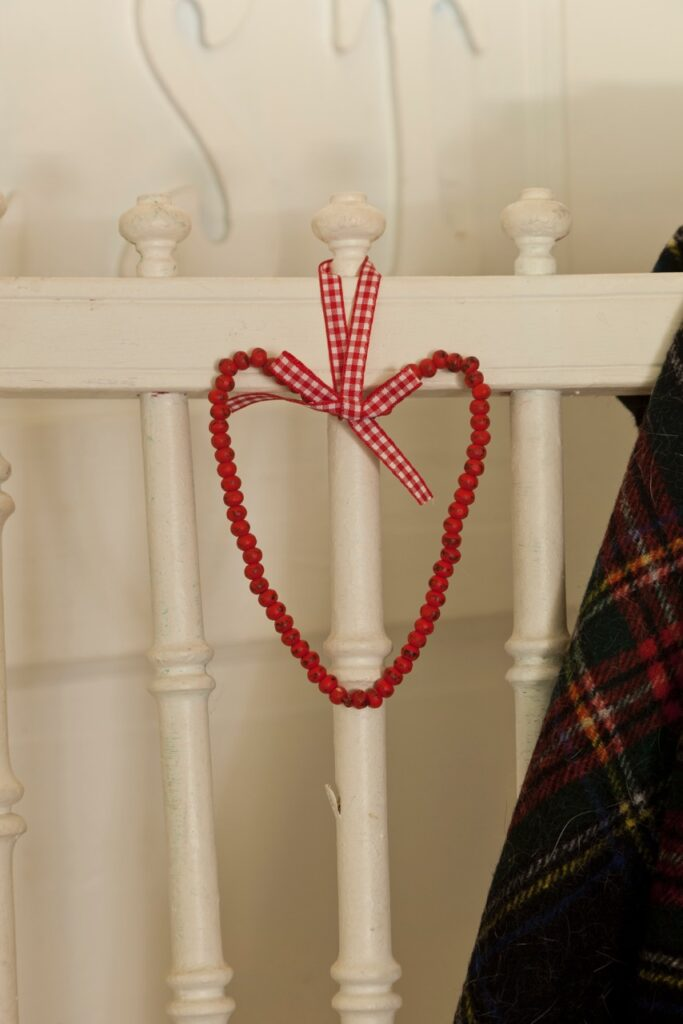 Red Beaded Heart on White Vintage Chair