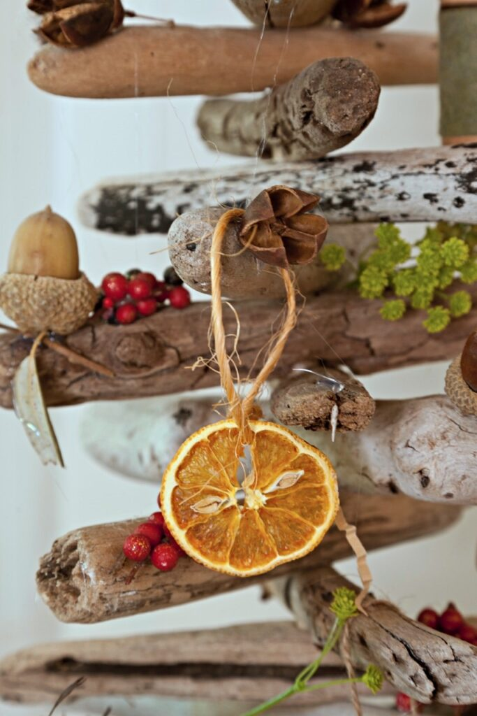 Orange Slices Hang from a Wooden Christmas Tree