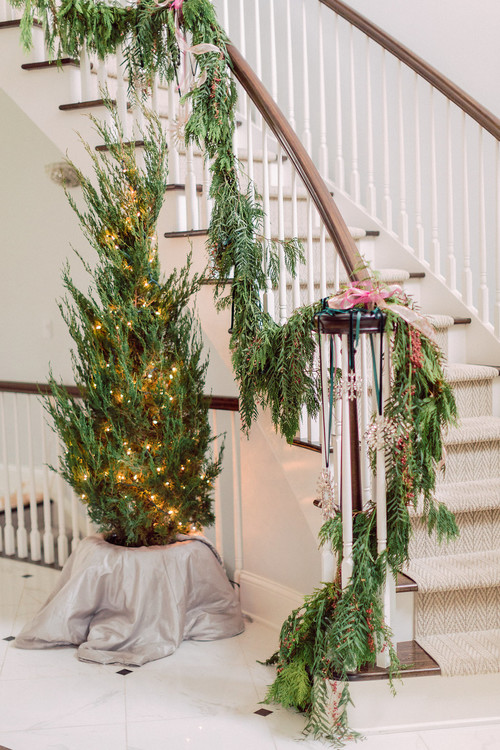 Elegant Curved Staircase and Foyer Decorated for Christmas