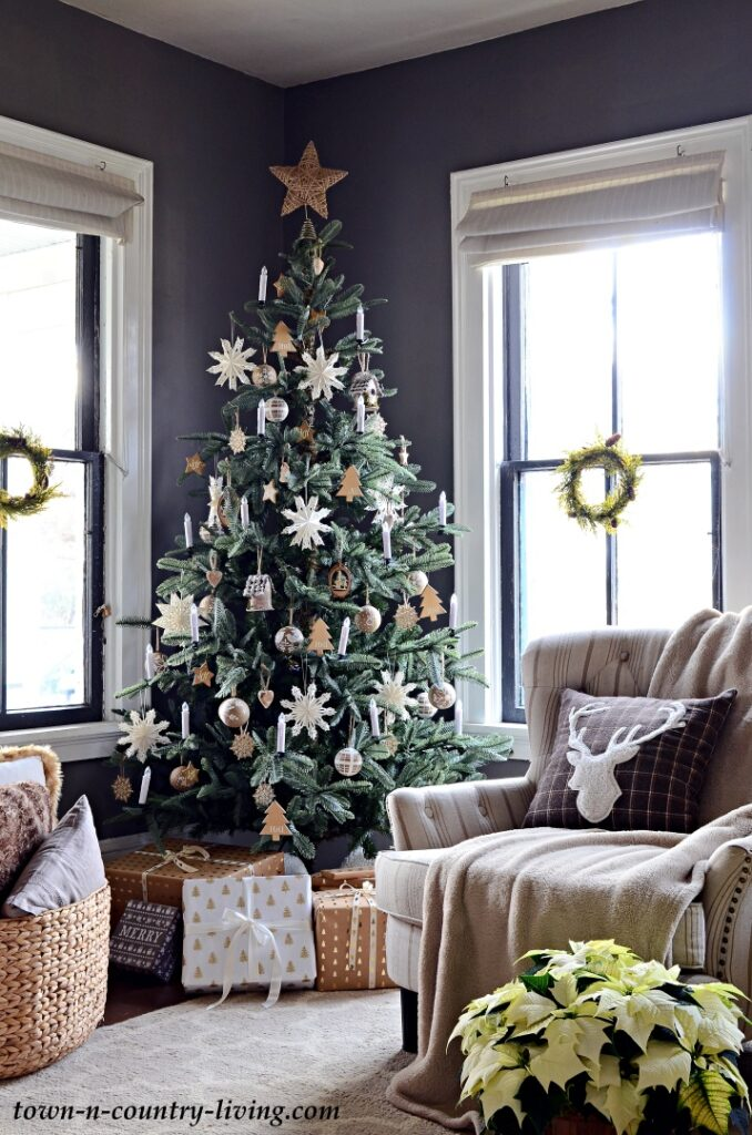 Scandinavian Style Christmas Tree in a Dark Gray Living Room