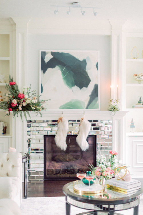 Glamorous Fireplace decorated with white furry Christmas stockings