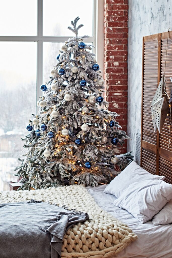 Frosty Christmas tree in a hygge style bedroom