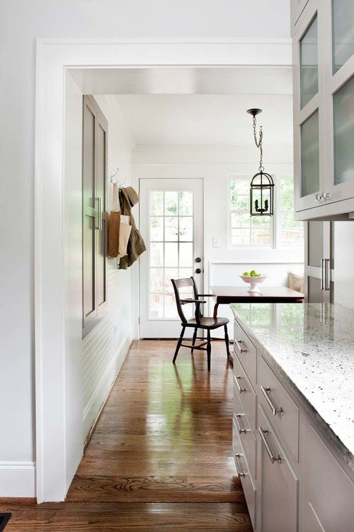Custom kitchen in older home with wood floor and shaker cabinets