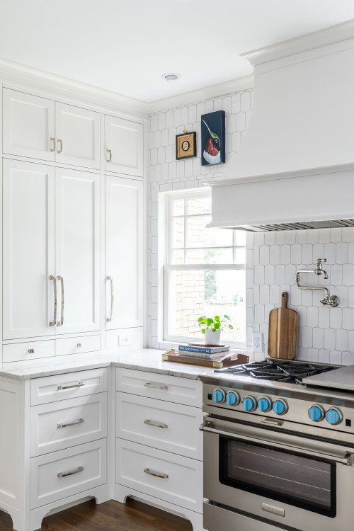 Light blue knobs on kitchen stove