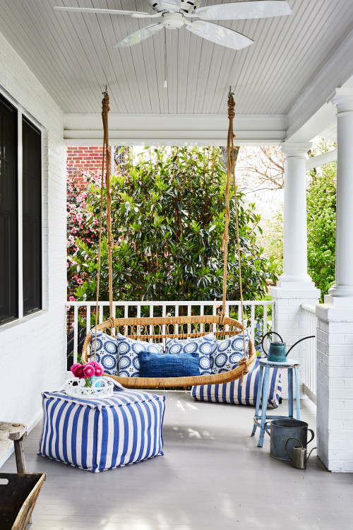 Rattan porch swing on front porch