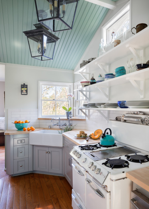 Corner Farmhouse Sink in Small Galley Kitchen with Vaulted Ceiling and Shaker Cabinets