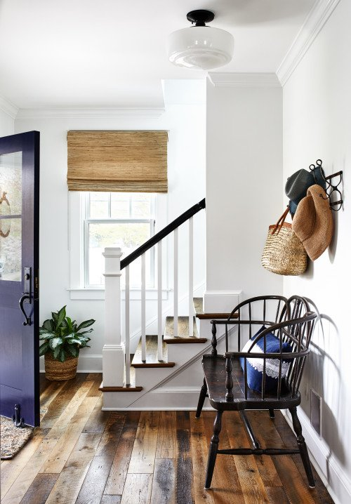 Farmhouse Bungalow Entryway with Vintage Bench and Old Wood Floors