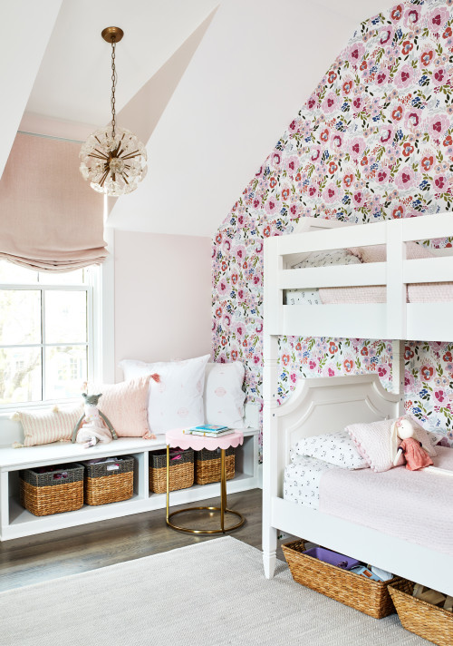 Girls bedroom with floral wallpaper and white bunk beds