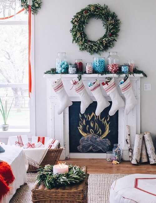 White Christmas Fireplace with Stockings and Wreath