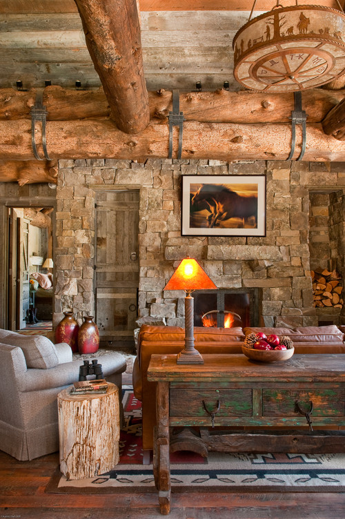 Rustic Living Room with Stone Walls and Wooden Tree Beams