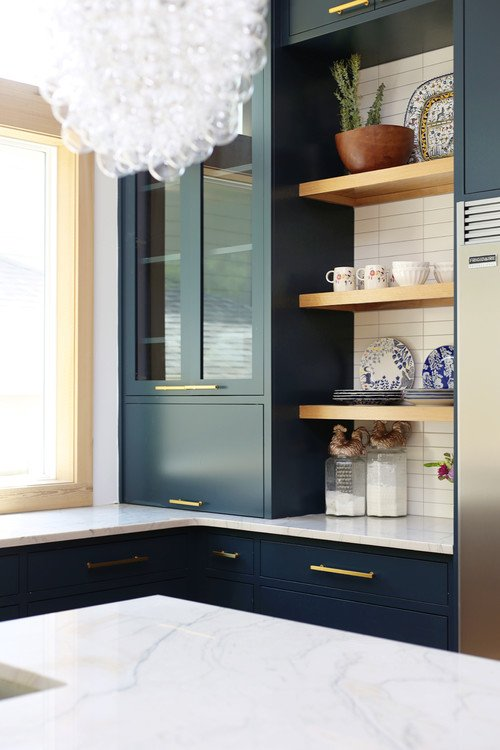 Navy blue cabinets and open shelving in minimalist kitchen