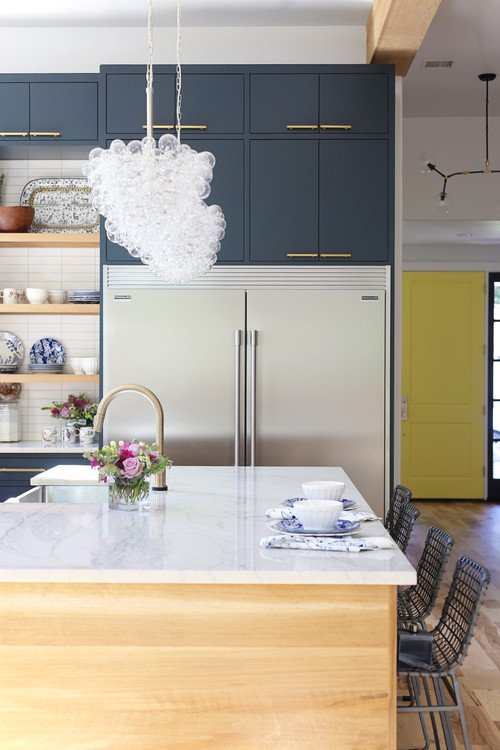 Large kitchen island with pair of pendant bubble light fixtures