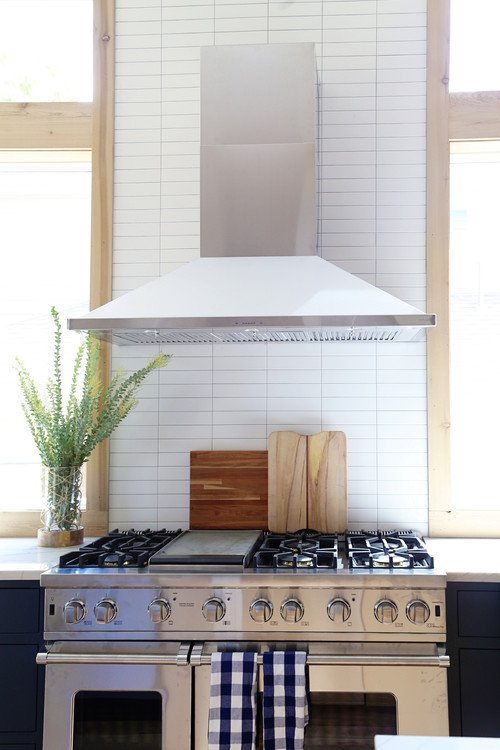 Industrial Style Stove and Hood Vent  in Transitional Kitchen