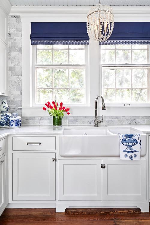 White Kitchen Cabinets with Dark Blue Accents
