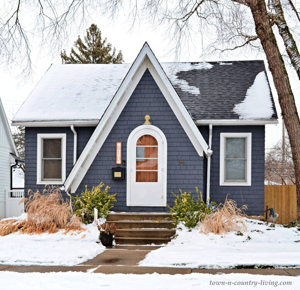 Small Dark Blue Cottage in the Snow
