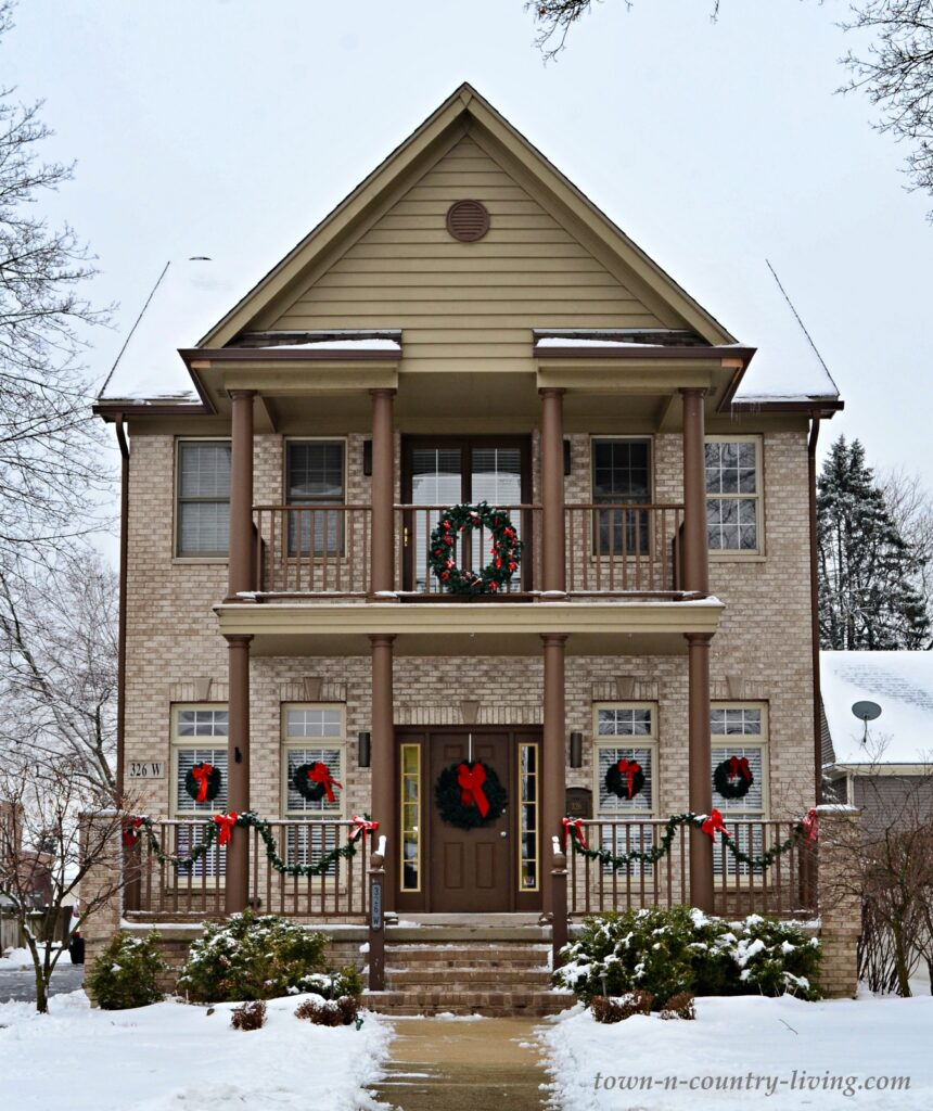 Two Story Porch on Neutral Home Exterior