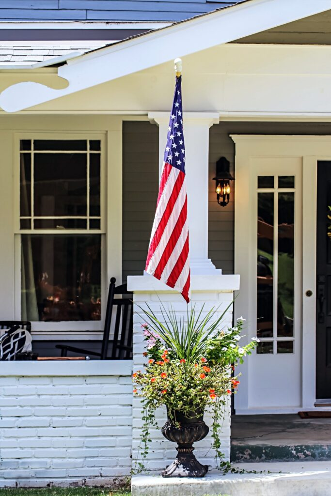 Gray Bungalow Porch with US Flag
