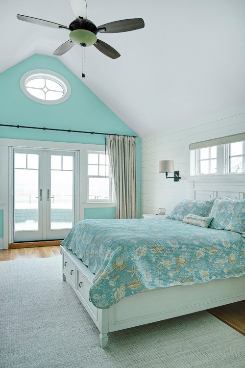Blue and White Beach Style Bedroom with Vaulted Ceiling and French Doors