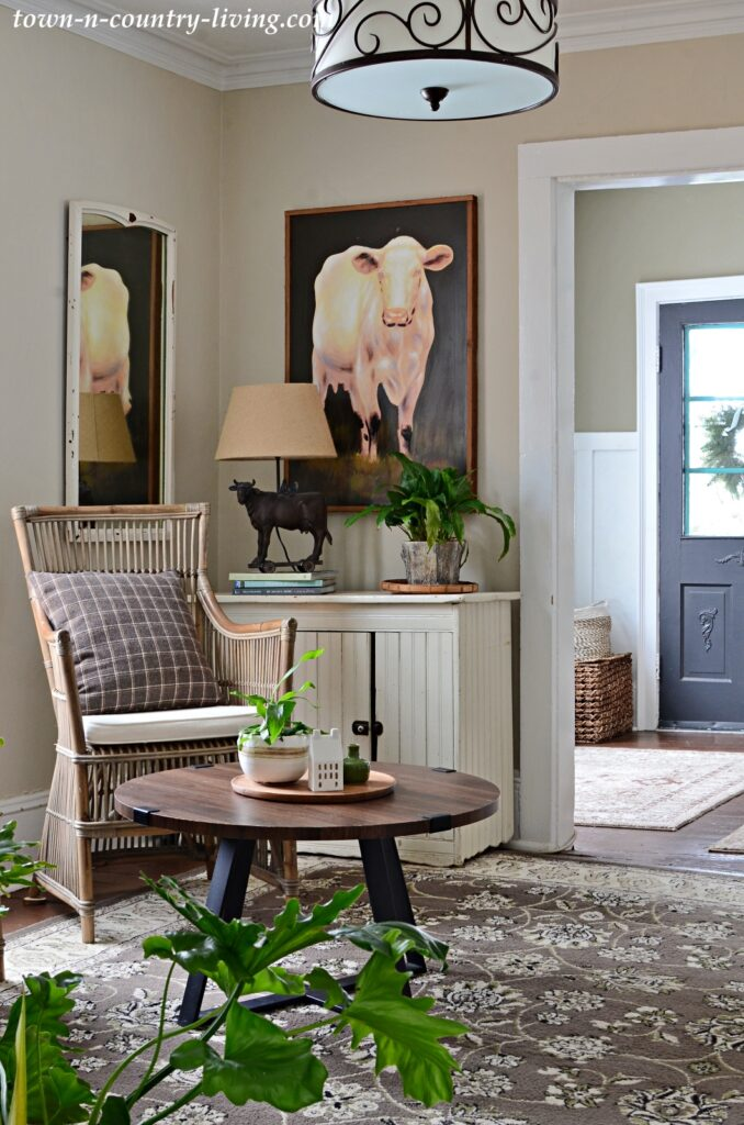 Country Style Sitting Room with Large Cow Painting