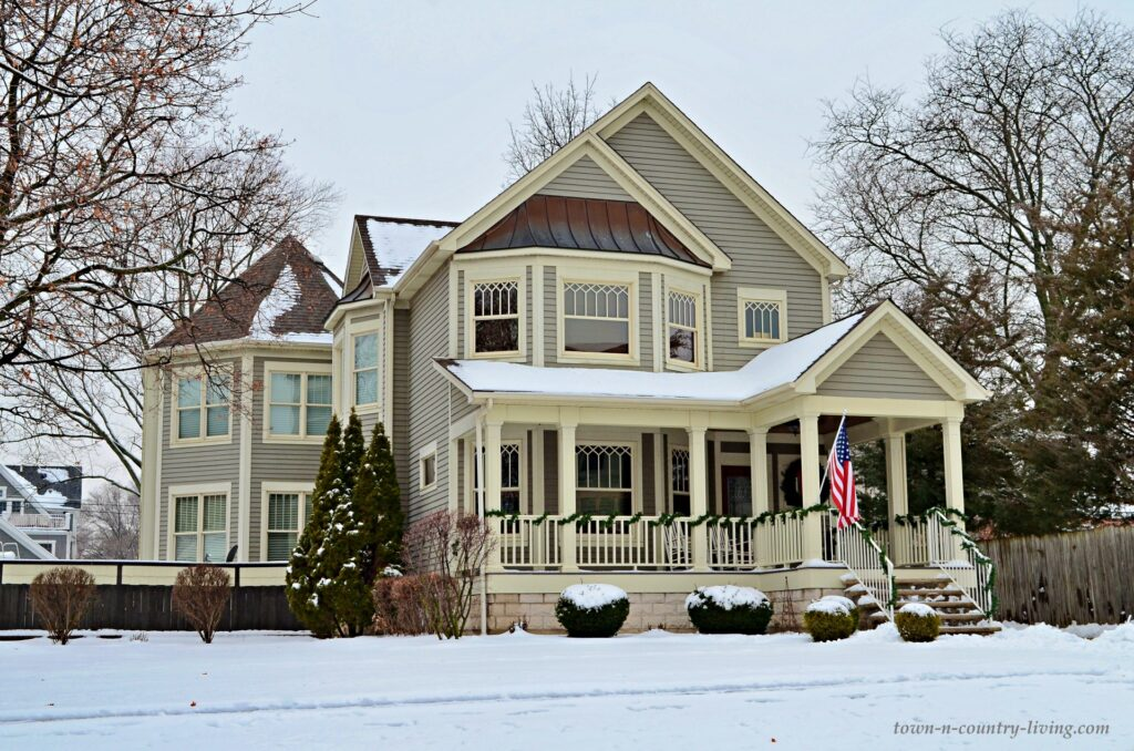 Large Tan Victorian Home with Full Front Porch