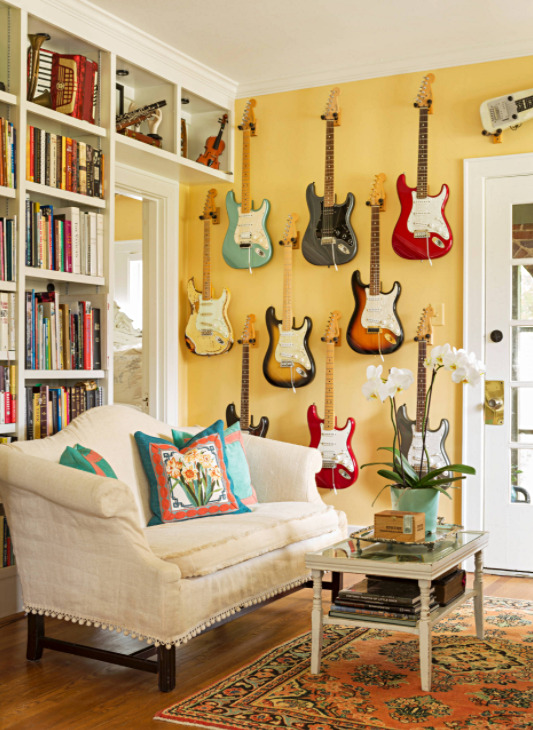 Electric Guitars as Wall Decor in Yellow Living Room