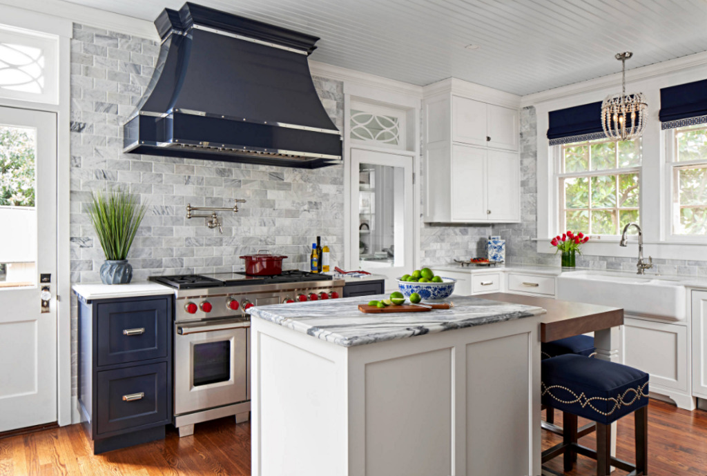 Expansive 1900s Kitchen Remodel in White and Navy Blue - with Gray Marbled Counter Tops and Tile