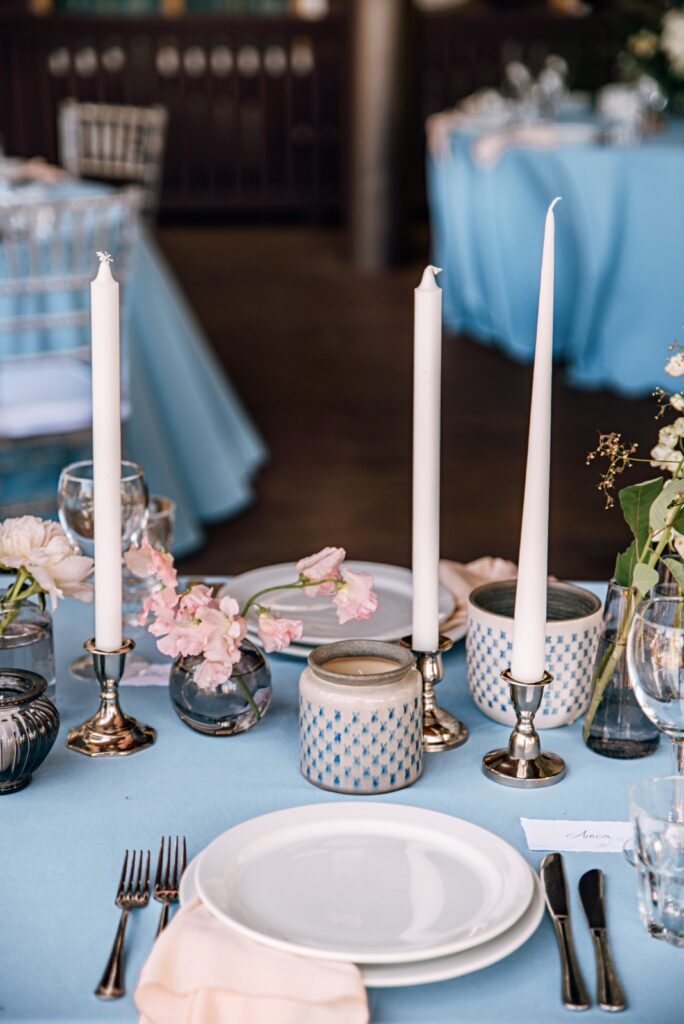 Dining Table with Sky Blue Linens and White Candles