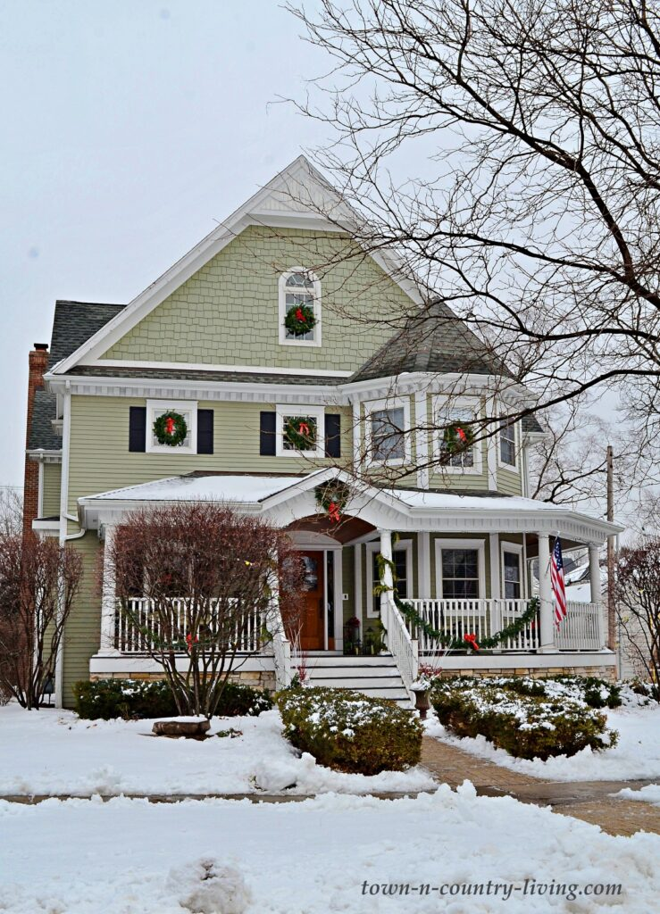 Light Green Victorian House in the Snow