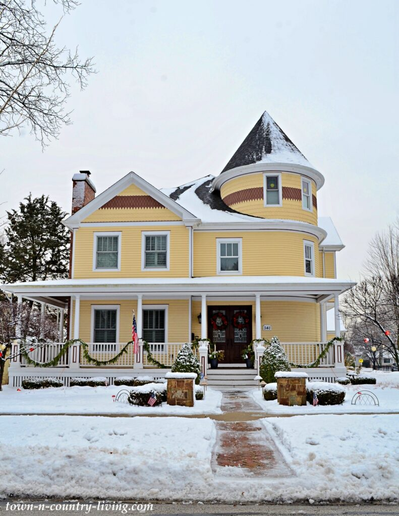 Old Yellow Victorian House with Wrap Around Porch