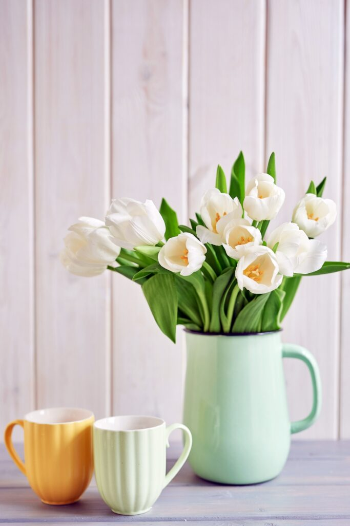 Mint green pitcher with white tulips
