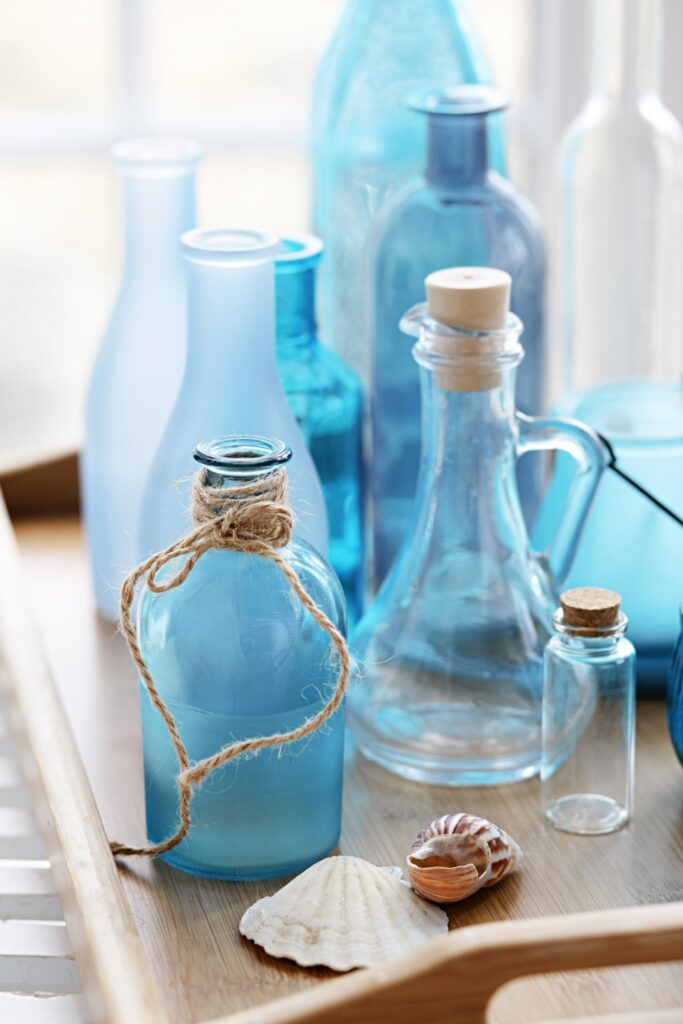 Collection of blue vintage bottles on a wooden tray