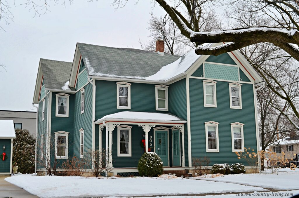 Dark Teal Victorian House in the Snow