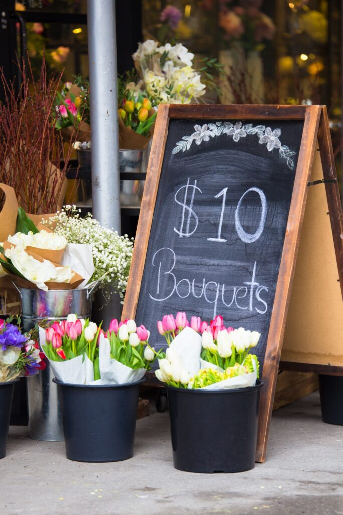 Colorful Tulips for Sale in Buckets with a Chalkboard Sign