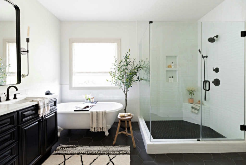 Updated Bathroom with White Claw Foot Tub and Walk-In Glass Shower