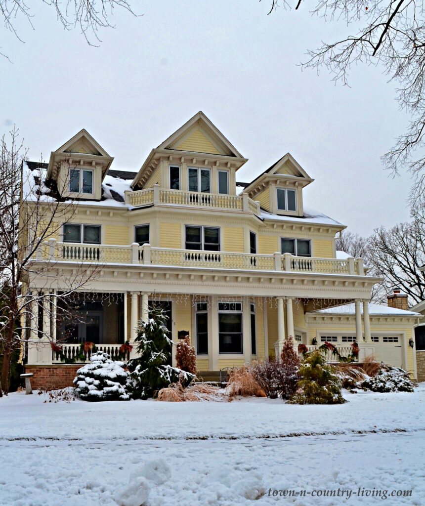 Large Yellow Two-Story Home in the Snow