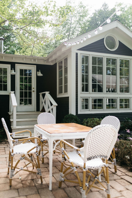 Patio with White Furniture at Dark Gray Cottage