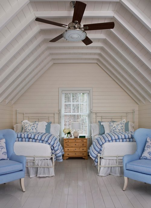 Pale blue and white bedroom with twin iron beds