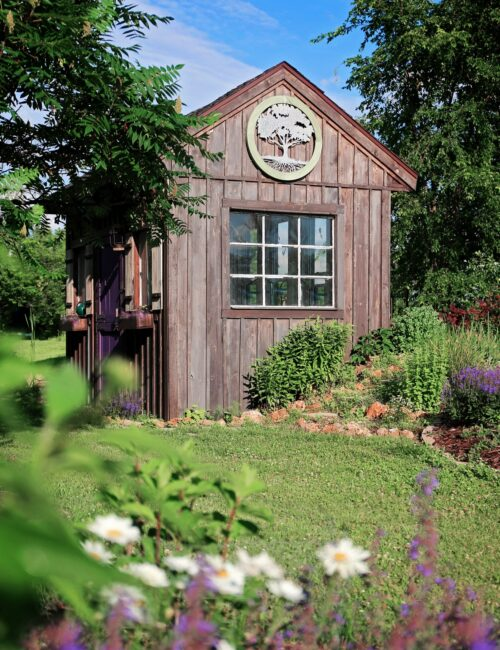 Natural wood potting shed with window