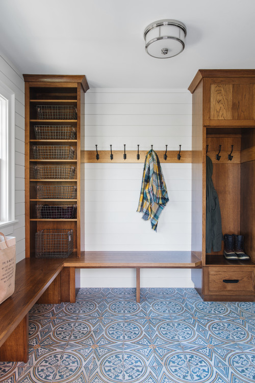 Farmhouse mudroom with patterned tile floor